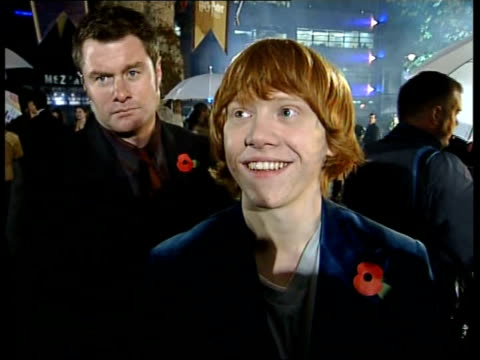 new harry potter film 'the goblet of fire' london premiere england london leicester square actress emma watson arriving for premiers cms actor rupert... - 2005 stock videos & royalty-free footage