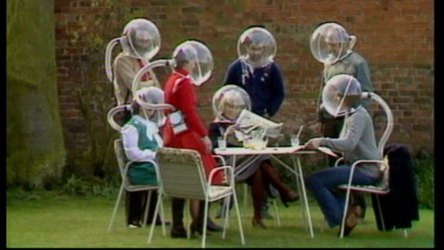 new hayfever treatment promises relief for sufferers s21020601 pershore various of hayfever sufferers wearing perpex helmets and filtered air... - lawn stock videos & royalty-free footage