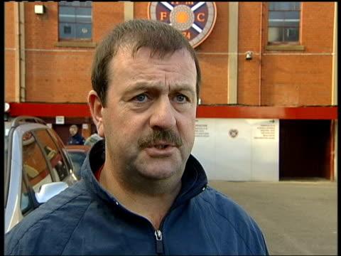 stockvideo's en b-roll-footage met new hearts owner installs his son as chairman; edinburgh: tynecastle stadium: gv sign on wall of stadium vox pops - voorzitter