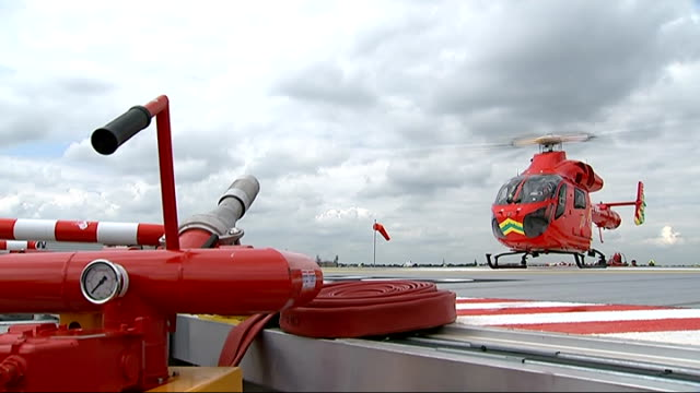 new helipad at st george's hospital in tooting london air ambulance helicopter landing on helipad pilots in cockpit dave rolfe interview sot... - helipad stock videos & royalty-free footage