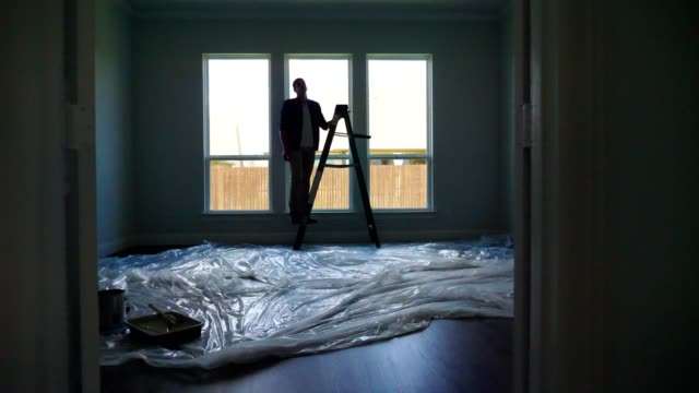 new homeowner prepares to paint a room in his home - looking around stock videos & royalty-free footage