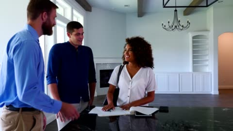 new homeowners sign document with realtor - signing stock videos & royalty-free footage