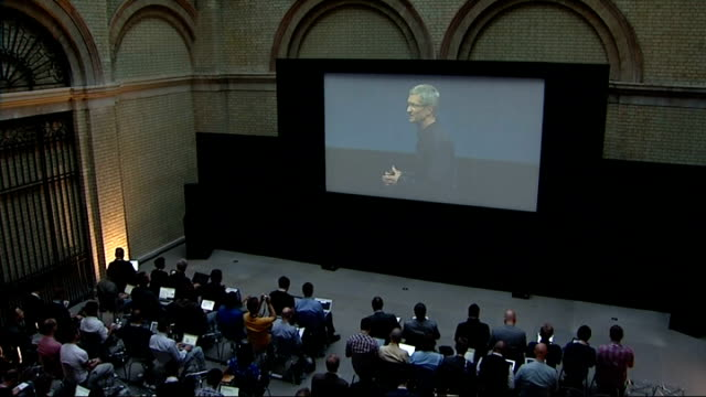London Covent Garden INT Gvs press waiting for launch / Tim Cook press conference on big screen SOT Good morning this is my first launch / It is a...