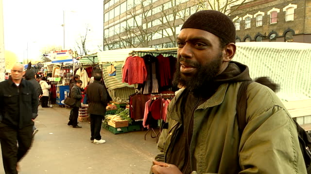 new issue of charlie hebdo magazine published following paris shootings; england: east london: ext people along street - the gherkin in background... - top of the pops stock videos & royalty-free footage