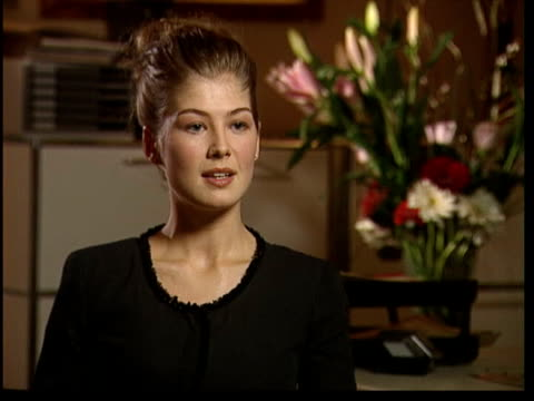 new james bond film actress rosamund pike rosamund pike interview sot talks of how she got the job as a bond girl i/c - bond girl fictional character stock videos & royalty-free footage