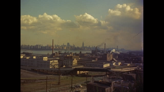 ws new jerseu industrial district with new york city skyline, empire state building in background / united states - elevated road stock videos & royalty-free footage