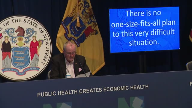 new jersey governor phil murphy enters a press briefing on school reopening amid the coronavirus pandemic in trenton, new jersey. - healthcare and medicine or illness or food and drink or fitness or exercise or wellbeing stock videos & royalty-free footage