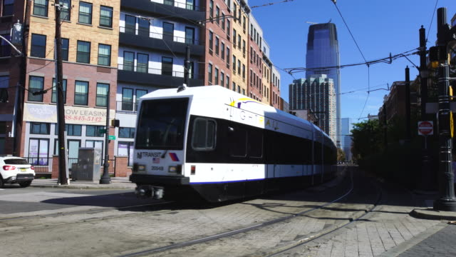 New Jersey Light Rail Trains running through the residential area.