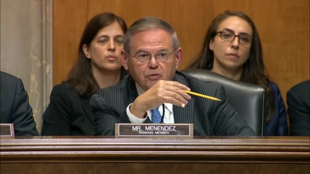 New Jersey Senator Bob Menendez argues with Secretary of State Mike Pompeo at a Senate Foreign Relations Committee hearing about whether statements...