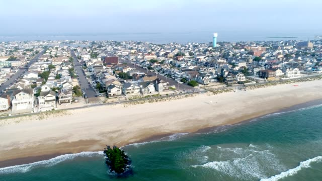 new jersey shore town flying in from the ocean toward bay - new jersey stock videos & royalty-free footage