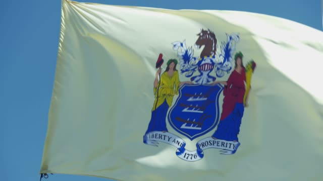 new jersey state flag waving in the breeze - new jersey stock videos & royalty-free footage
