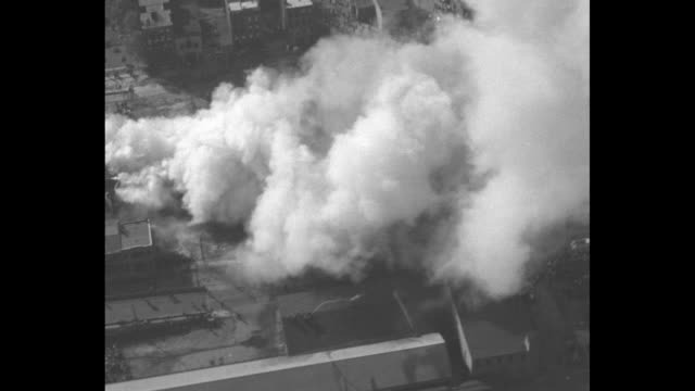 new jersey superimposed on aerial views of fire at penick drug company / vs people watching the fire that has caused a wall to partially collapse a... - fire escape stock videos & royalty-free footage