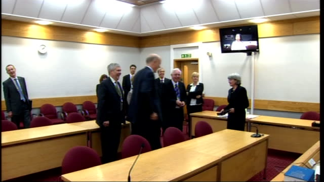 new justice minister chris grayling visits leicester grayling speaking to police officer via livecam installed in court room / grayling sits in... - court room stock-videos und b-roll-filmmaterial