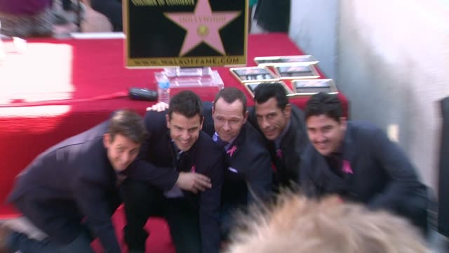 New Kids On The Block pose with star at New Kids On The Block honored with star on the Hollywood Walk of Fame in Hollywood CA on