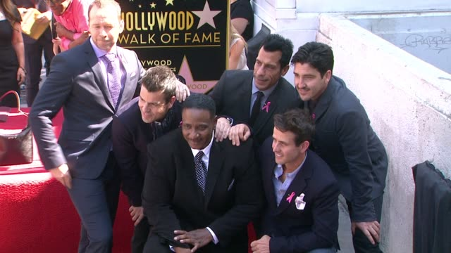 New Kids On The Block posing for pictures with Maurice Starr at New Kids On The Block honored with star on the Hollywood Walk of Fame in Hollywood CA...