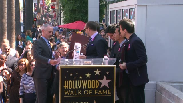 New Kids On The Block posing with certificates at New Kids On The Block honored with star on the Hollywood Walk of Fame in Hollywood CA on