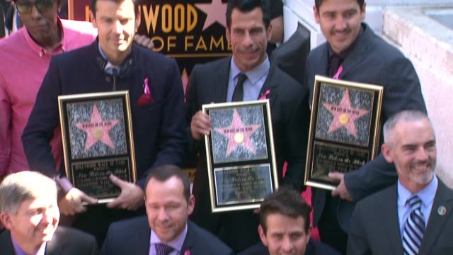 new kids on the block posing with plaques at new kids on the block honored with star on the hollywood walk of fame in hollywood ca on - walk of fame stock videos & royalty-free footage