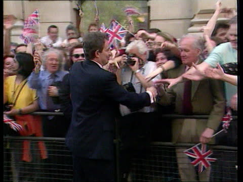 anniversary of election; lib england: london: downing street: ext pm tony blair mp and wife cherie on walkabout amidst cheering crowds after election... - wife stock videos & royalty-free footage