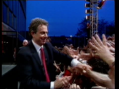 stockvideo's en b-roll-footage met anniversary of election lib england london royal festival hall tony blair mp with wife cherie shaking hands with supporters after election win pm... - tony blair