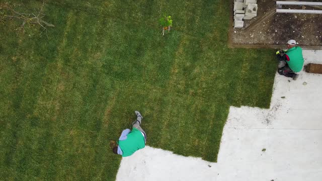 new lawn being installed in the backyard - installing stock videos & royalty-free footage