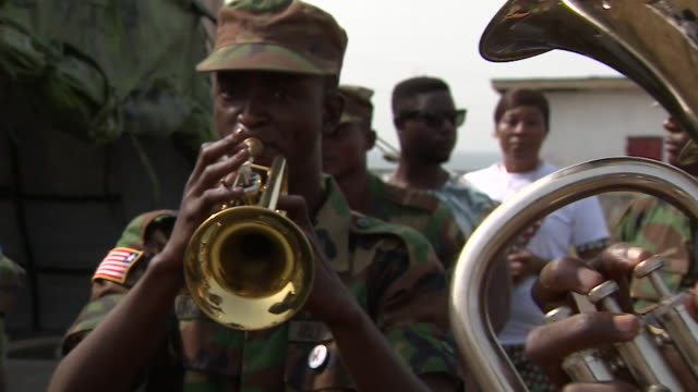 New Liberian President George Weah being welcomed by an Army band for a charity football match