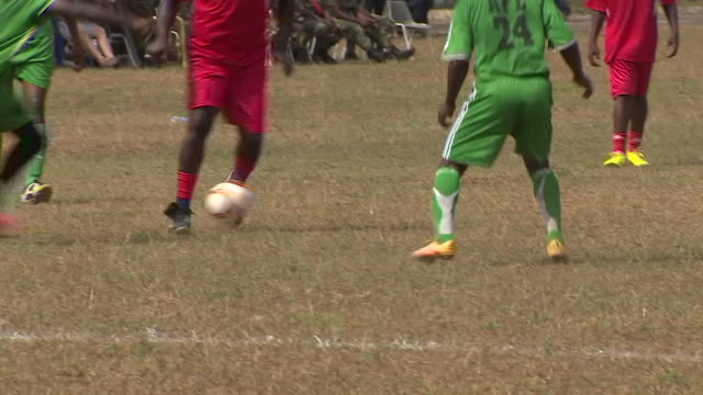 New Liberian President George Weah playing and scoring a goal during a football match against the Army