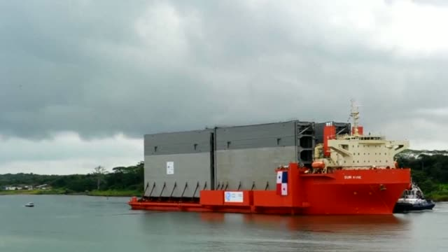 new locks arrive for the panama canal expansion which will allow the passage of freighters with a cargo capacity of up to 12000 containers clean new... - colon stock videos and b-roll footage