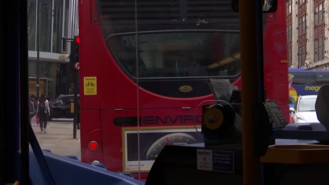 New London electric buses / Mayors meet to discuss air pollution ENGLAND London POV shot through front window as new BYD electric bus driven along...
