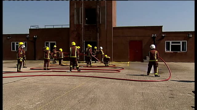 new london mayor visits youth project at dagenham fire station johnson watching next lewis and fire brigade officials / various of group of young... - brigade stock videos & royalty-free footage