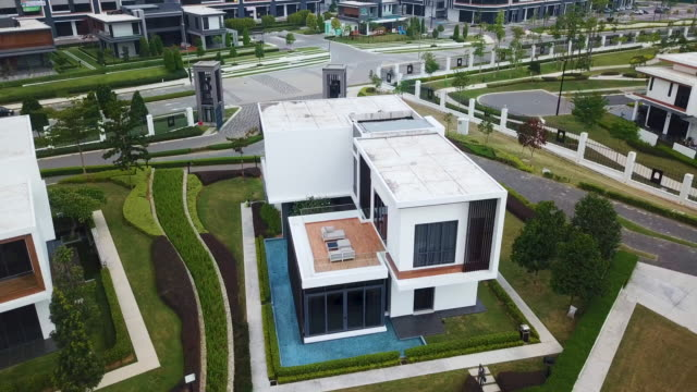 stockvideo's en b-roll-footage met new luxury modern houses with swimming pool - formal garden