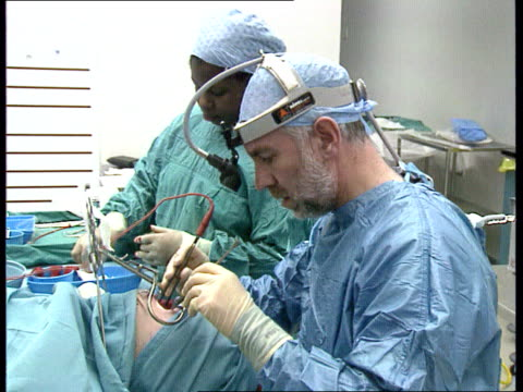 new means of detection/surgical instruments fear lib tonsil operation in progress bloody swab removed from mouth of patient swab pushed into mouth of... - bocca umana video stock e b–roll