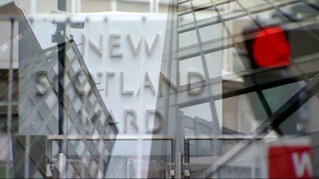 new metropolitan police commissioner bernard hoganhowe challenges ahead scotland yard ext revolving 'new scotland yard' sign scotland yard building... - 警視庁点の映像素材/bロール