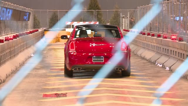 wgn new model cars being test driven on closed track at the 2017 chicago auto show on feb 11 2017 - 試運転点の映像素材/bロール
