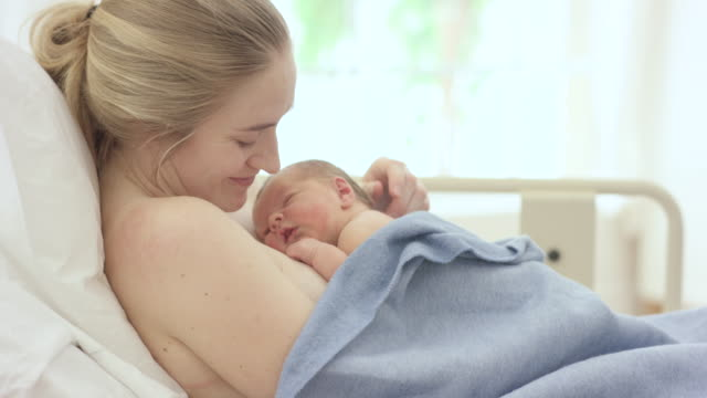 new mom bonding using skin to skin contact - newborn stock videos & royalty-free footage