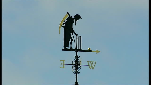 new 'mongoose' cricket bat old father time weathervane and grass being mowed - channel 4 news stock videos & royalty-free footage