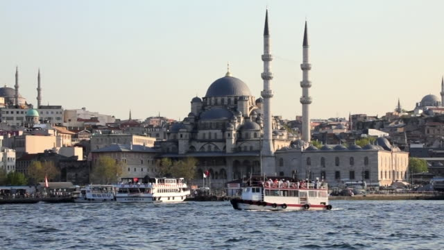 ws new mosque seen across golden horn, istanbul, turkey - golden horn istanbul stock videos and b-roll footage