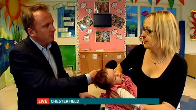 new mothers to receive shop vouchers to encourage breastfeeding england derbyshire chesterfield int reporter to camera at drop in breastfeeding... - breastfeeding stock videos and b-roll footage
