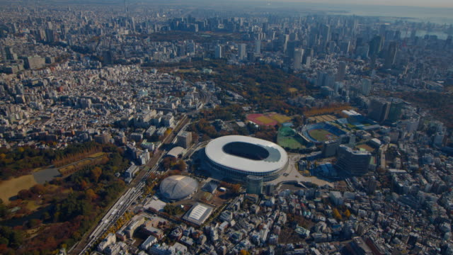 new national stadium aerial,tokyo,japan - finanzwirtschaft und industrie stock-videos und b-roll-filmmaterial