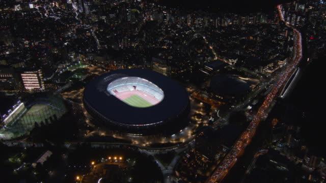 new national stadium light up aerial,tokyo,japan - tokyo japan video stock e b–roll