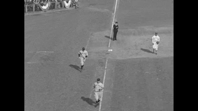 New NY Giants pitcher steps on mound replaced pitcher walks towards dugout / NY Yankee batter Lazerri hits foul ball / CU Lazerri hitting foul ball /...