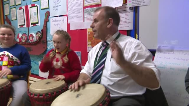 new ofsted chief hits out at failing schools; county durham: stockton-on-tees: the oak tree academy: various of children drumming in classroom - drum percussion instrument stock videos & royalty-free footage