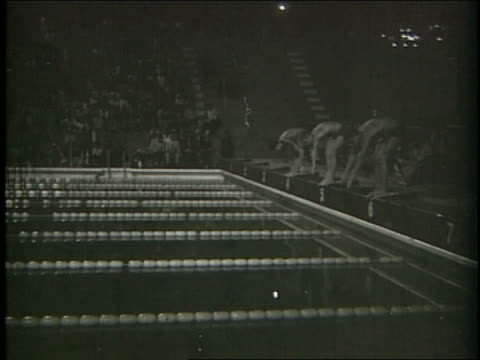 new olympicsized swimming pool at local club with particpation from some wellknown swimmers including luis alberto nicolao donna de varona susana... - 1964年点の映像素材/bロール