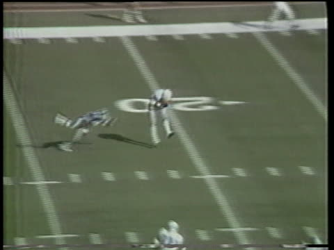 1984 MS New Orleans Breakers' Johnnie Walton throwing long pass to Frank Lockett who runs for touchdown and spikes ball in endzone in game against San Antonio Gunslingers/ San Antonio, Texas