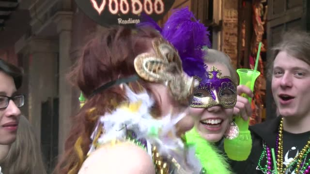 new orleans famed french quarter and its infamous main drag bourbon street filled with revelers who braved tuesdays rains to party hard on mardi gras... - gras stock videos and b-roll footage