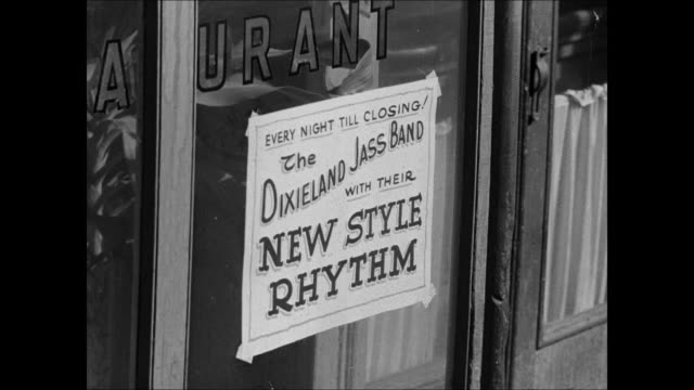 new orleans harbor street w/ carriage cafe sign 'dixieland jass band new style rhythm' cu hand playing piano w/ cigarette resting on key 1917... - 1916年点の映像素材/bロール