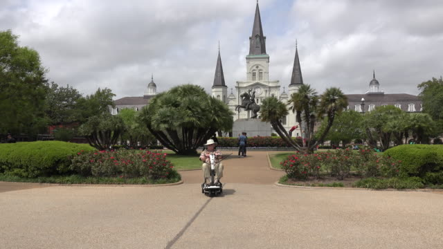 new orleans man and scooter at jackson square - cathedral stock videos & royalty-free footage