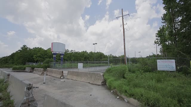 new orleans six flags amusement park abandoned after katrina / blight from over grown weeds and no trespassing signs their own sign still reads... - trespassing stock videos & royalty-free footage