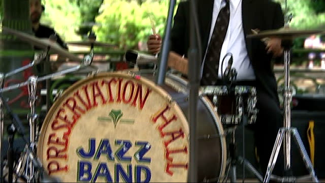 new orleans themed independence day celebrations in battersea park england london battersea ext **music heard sot** man playing trumpet pull out... - bandstand stock videos and b-roll footage