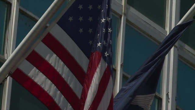new orleans, u.s. - american flags flying half-staff at city hall on wednesday, july 22, 2020. - town hall stock videos & royalty-free footage