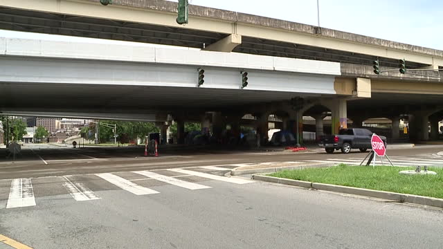 new orleans, u.s - homeless encampment under bridge along road in new orleans, on wednesday, august 25, 2021. - road marking stock videos & royalty-free footage